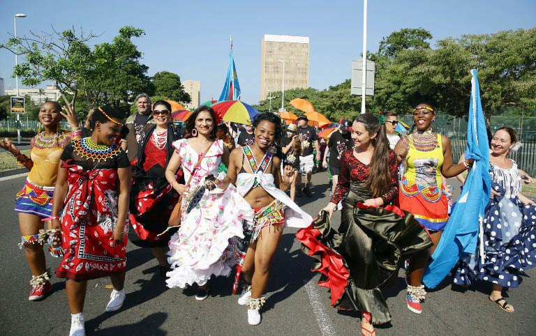 Hundreds of people adorned with traditional regalia from different cultures march through the streets of Durban on May 23, ahead of the he annual commemoration of the 1963 founding of the Organisation of African Unity, presently recognised as the African Union. (Pic: AFP)