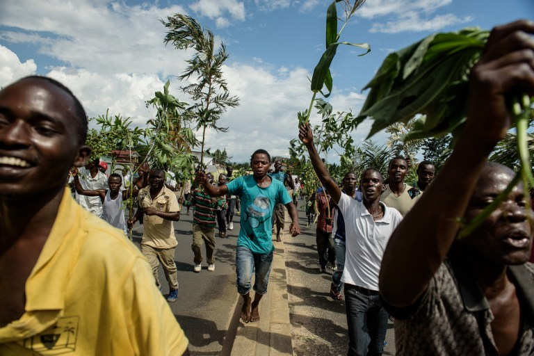 People celebrate in the streets of Bujumbura on May 13 2015 following the radio announcement that President Nkurunziza was overthrown. (Pic: AFP)