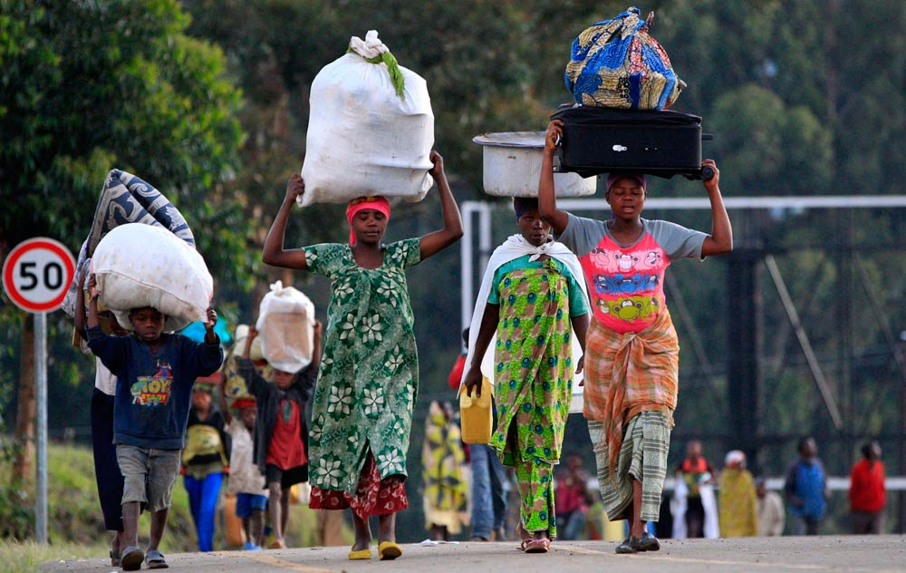 People displaced by fighting between the Congolese army and M23 rebels in Bunagana in the eastern Democratic Republic of Congo, make their way home. (Pic: Reuters)