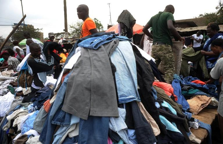 "Traders work in Gikomba Market on July 10 2014 in Nairobi. Locally known as ""Mitumba"", second-hand clothes trade has developed from mainly international charitable donations to become a bustling business sector. (Pic: AFP)"