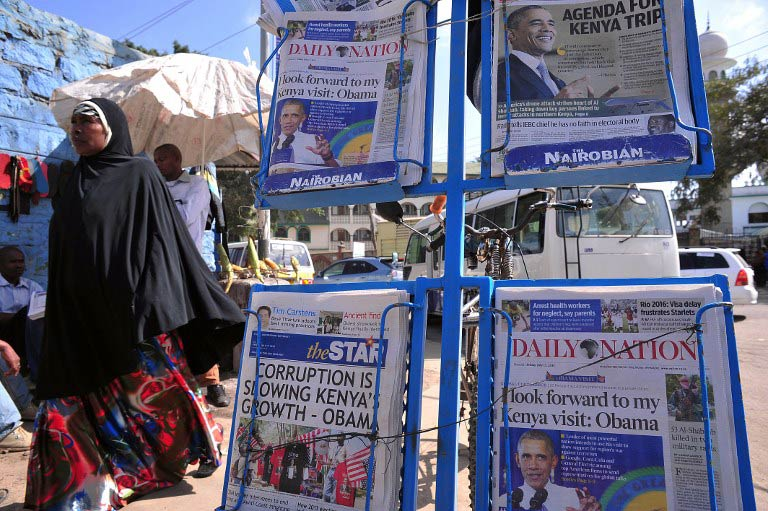 Newspapers bearing headlines on US President Barack Obama's upcoming visit to Kenya. (Pic: AFP)