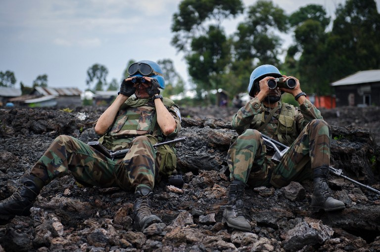 Uruguayan United Nations peacekeepers look through binoculars at M23 rebel positions on the outskirts of Goma, in eastern Democratic Republic of the Congo, on November 18, 2012. (Pic: AFP)