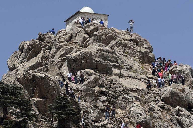 "Pilgrims climb the Azro Nethor peak in the Djurdjura Mountain rangeto reach ""el-Jammaa Oufella"" (the upstairs mosque). (Pic: AFP)"