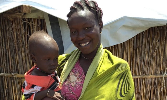 Julia John with one-year-old Tuach, in Bentiu camp. Photograph: Antony Loewenstein