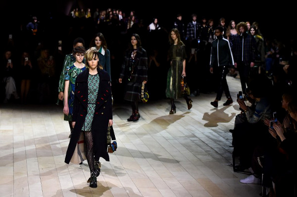 Models present creations during the Burberry Prorsum catwalk show at the Autumn / Winter 2016 London Fashion Week in London on February 22, 2016. (Ben Stansall / AFP)